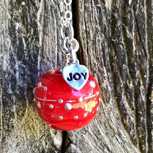 """Red holiday bead with """"joy"""" charm on 19in silver chain with garnets on the clasp"""