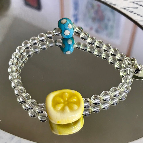 Yellow flower bead bracelet with turquoise and ivory dots