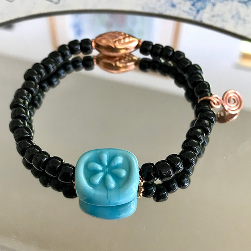 Turquoise glass flower with black and copper beads