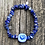 Thumbnail: Blue daisy heart lampwork strung on lapis lazuli