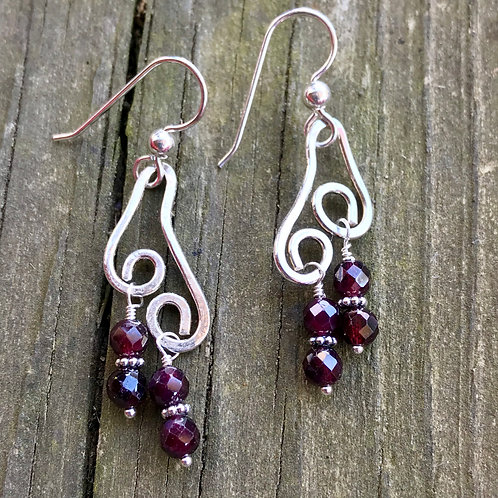 Garnet dangles, sterling silver with double swirls