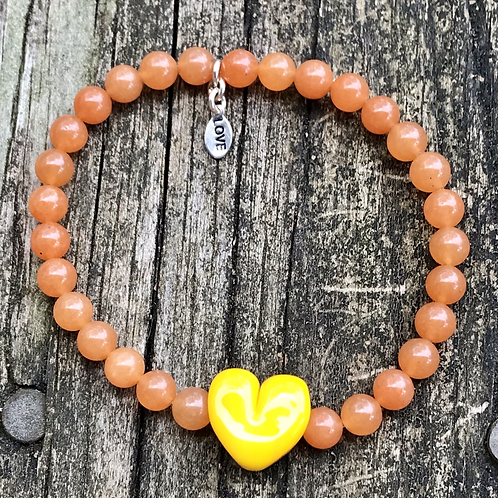 Glass heart lampwork bead strung on carnelian