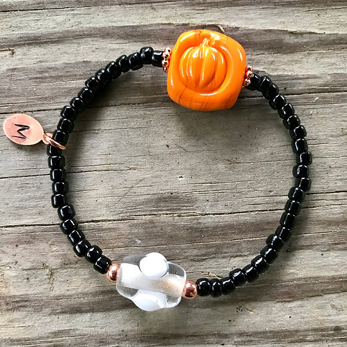 Pumpkin bracelet with copper charm and black spacer beads