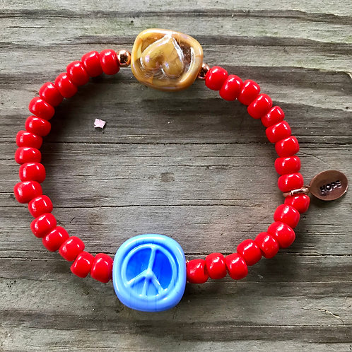 Blue peace sign and O/Y heart stamp bead