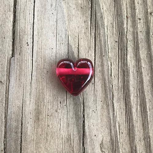 Rhea heart with horizontal hole