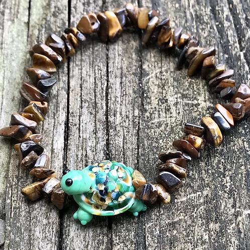 Turtle lampwork bead strung on tigers eye