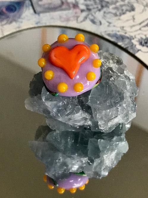 Lentil Rapunzal base with orange heart and rubio flower