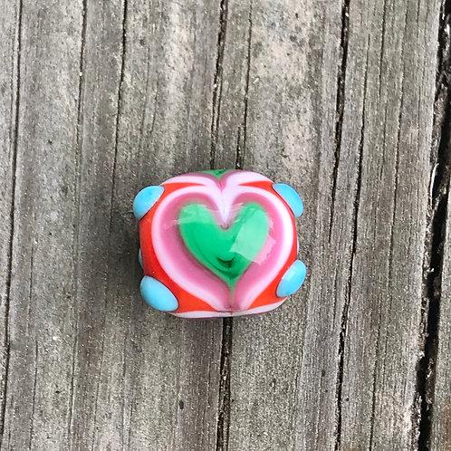 Raked rainbow heart round