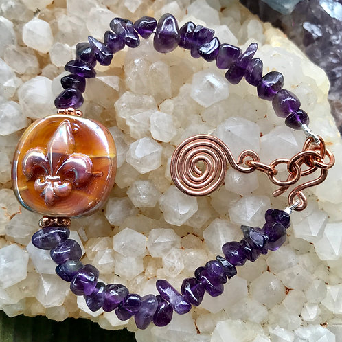Fleur de lis silver glass lampwork bead, strung with amethyst