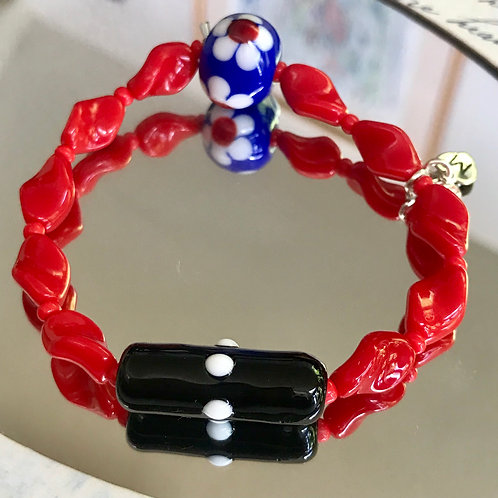 Black tube with with white dots radius and blue flower bead