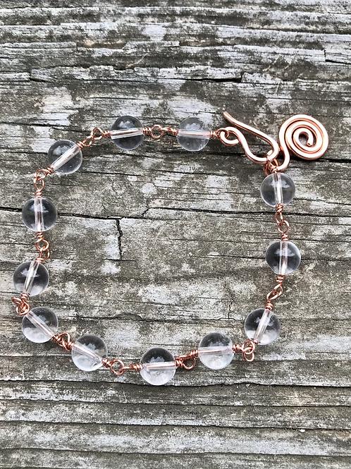 Crystal clear quartz and copper bracelet