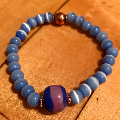 Blue and purple stripe lampwork bead with blue cats eye