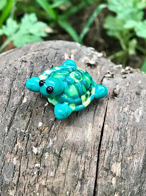 Glass turtle bead