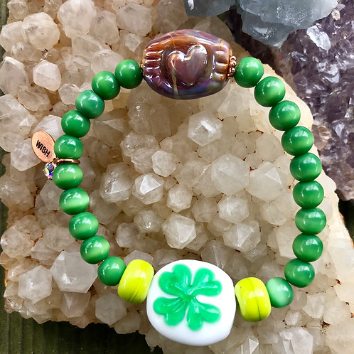 4 leaf clover, and heart stamped lampwork bead, strung with green cats eye.