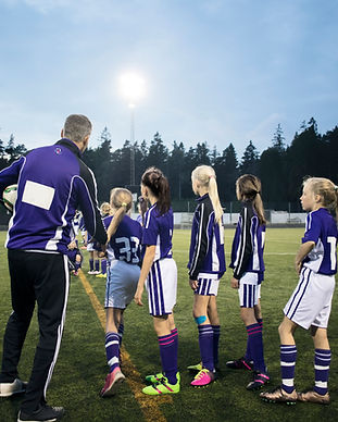 Équipe de football féminin en pratique