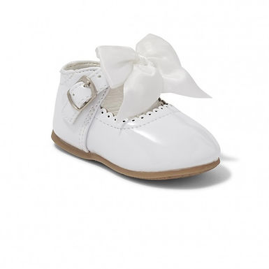 White Kylies with silk bow