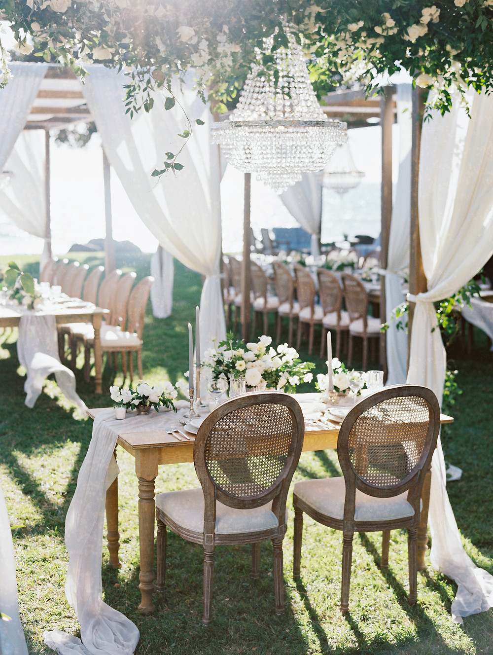Wedding reception dining canopy with crystal chandelier
