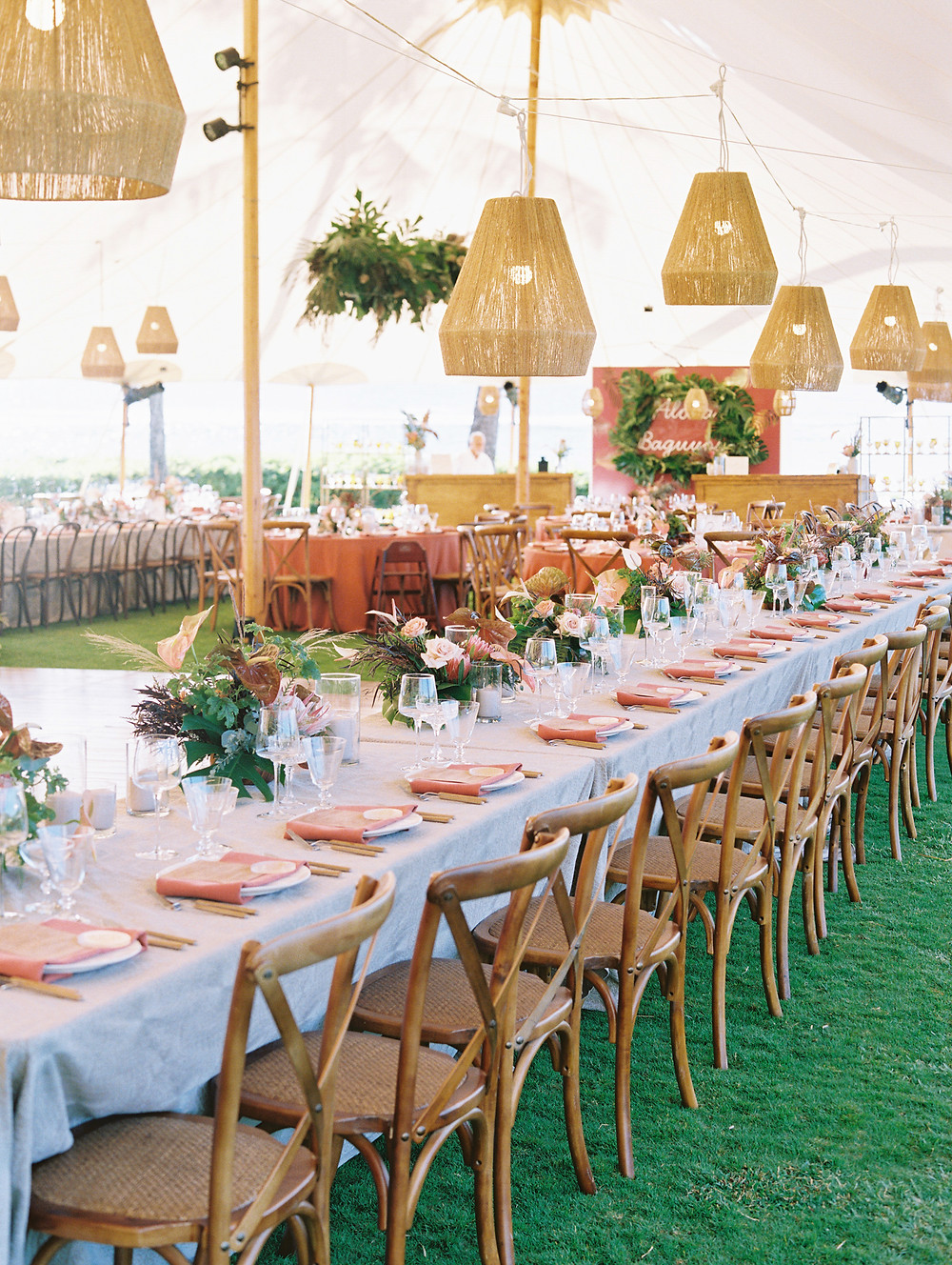 Maui Sailcloth Tent wedding reception with hanging rattan pendant lights