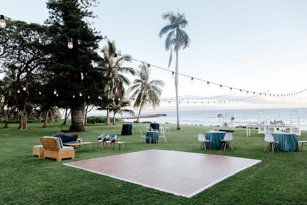 Cocktail Hour decor with cafe rope lights at Maui wedding venue Olowalu Plantation House