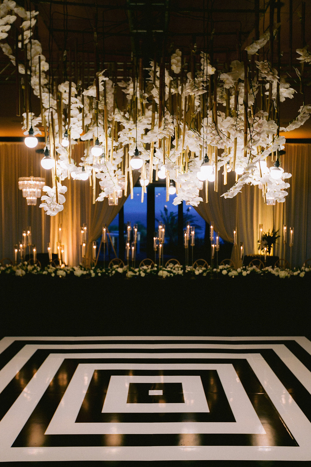 Black and white dance floor with hanging orchid lighting