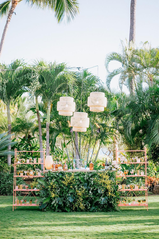 Custom tropical wedding bar with hanging rattan pendant lights
