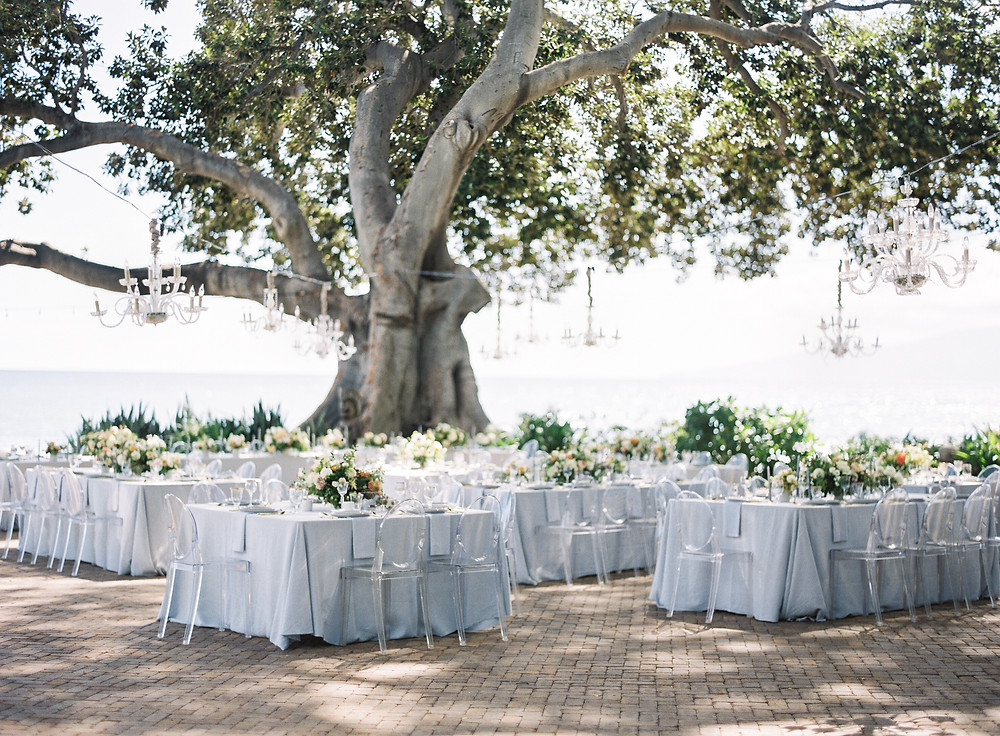 Modern square reception tables with hanging chandeliers at Maui Wedding venue Olowalu Plantation House