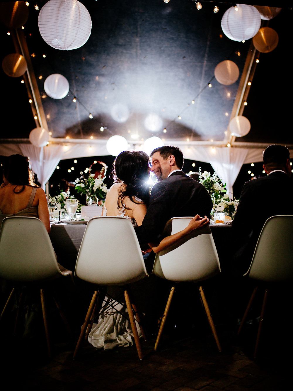 Clear span wedding tent with white paper lanterns