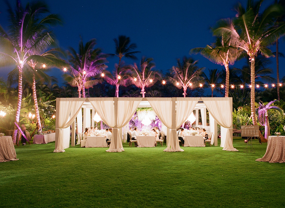 Wedding dining canopy with lighting at Four Seasons Resorts Lanai