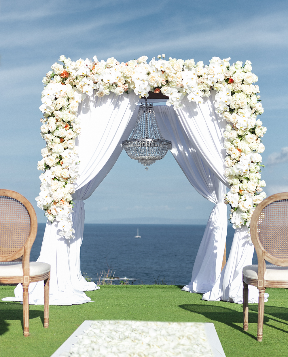 White floral ceremony arch at Four Seasons Resorts Lanai