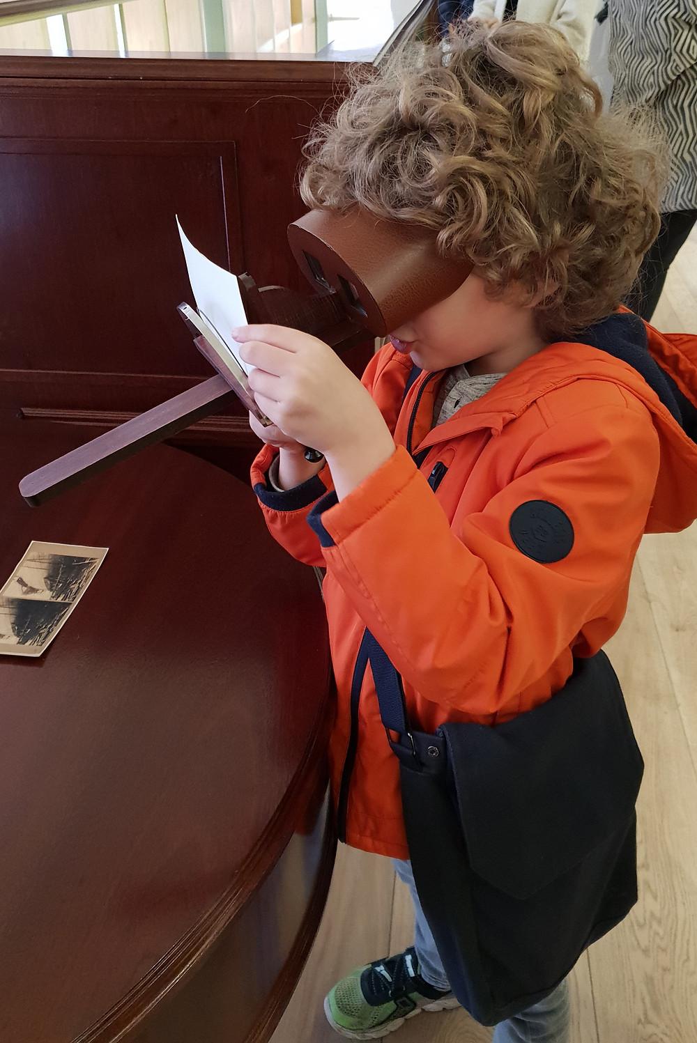 Boy peering through old-fashioned glasses