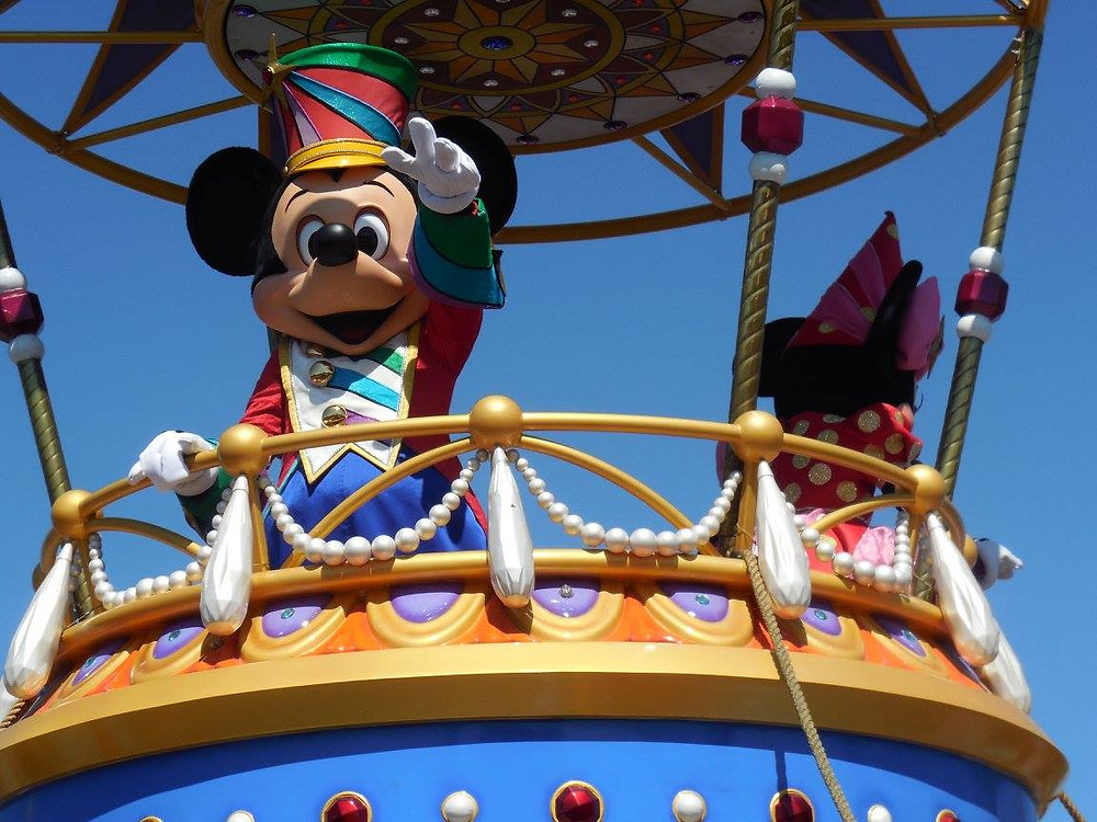 Mickey Mouse waving from a float