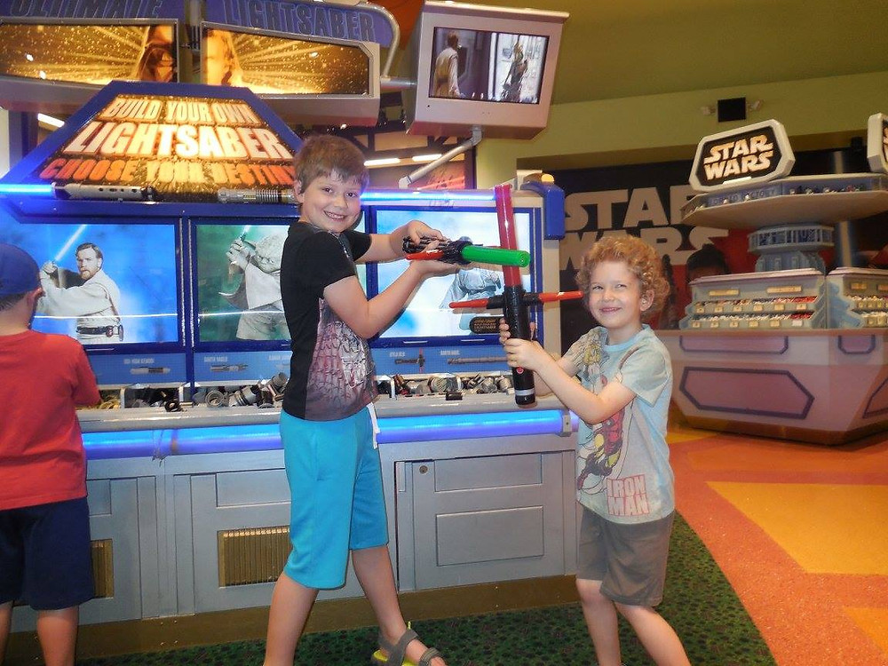 Boys playing with lightsabers