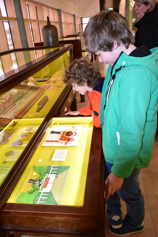 Children looking at museum artefacts