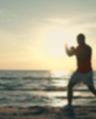 strong-man-boxing-at-sunset-at-the-beach
