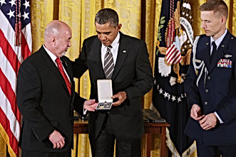 MMIA Executive Director, Michael Dorman receving Presidential Citizens Medal from President Obama