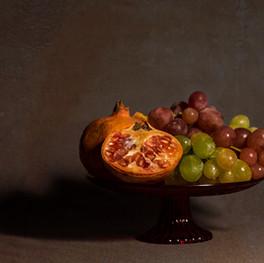 Frutero granada y uvas