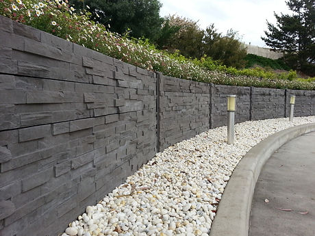stacked stone retaining wall with solar