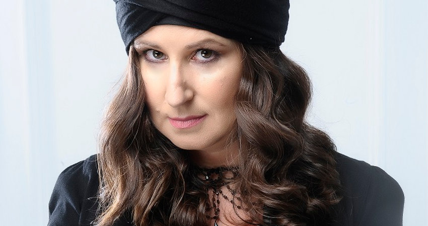 Amelie Appleby, Fun Fortune Teller in a Black Turban with her Crystal Ball