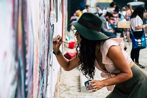 photo-of-woman-painting-on-wall-1340502.