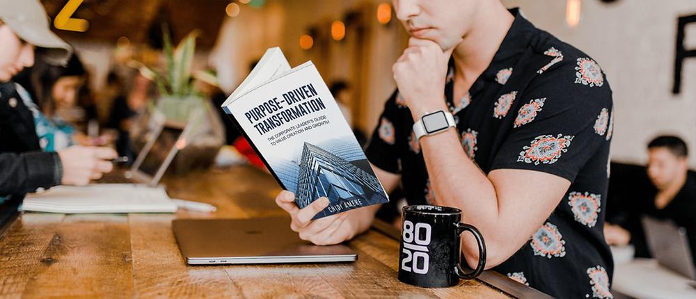 A man reading Purpose-Driven Transformation