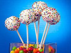white cake pops with sprinkles.jpeg