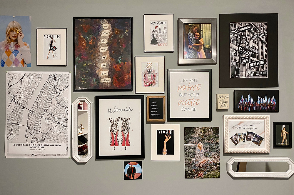 A collage of images and decor formed into a personalized gallery wall.