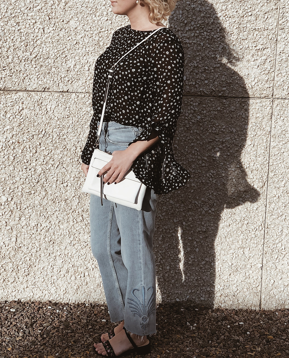 flroal print blouse with jeans