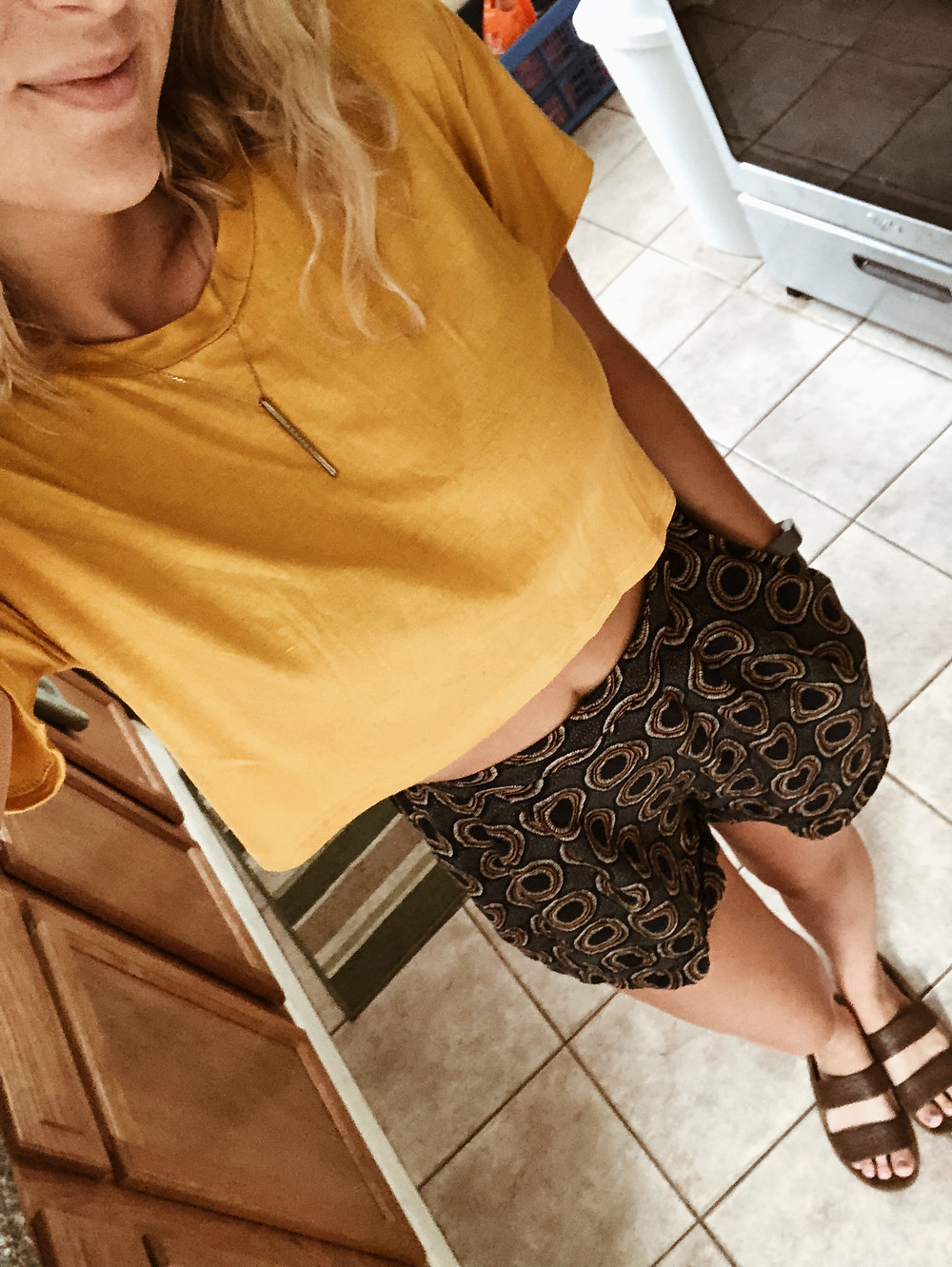 gold top with high waist shorts