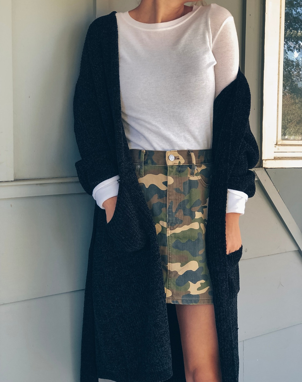 Camo skirt with white long-sleeve and black cardigan
