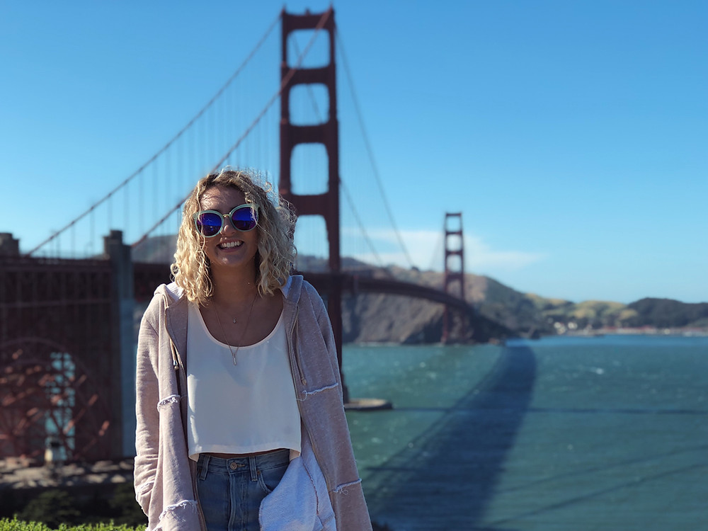 jeans, cropped tank top and zip-up poncho cardigan; golden gate bridge