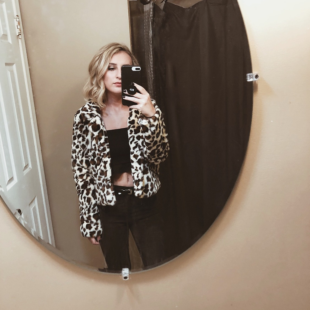 All black outfit with faux-fur leopard print jacket