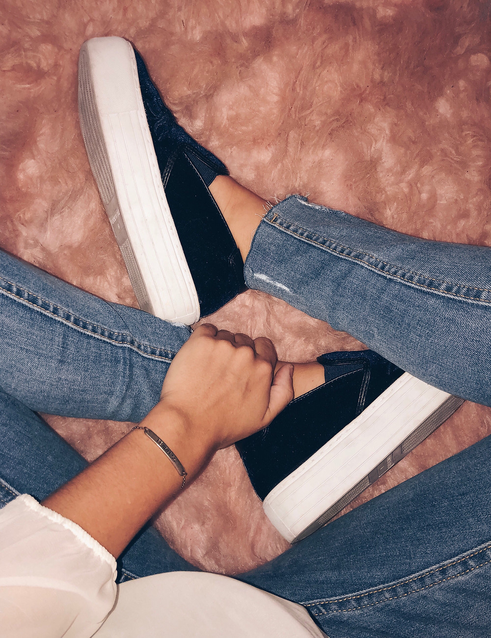 platform sneakers and blue jeans