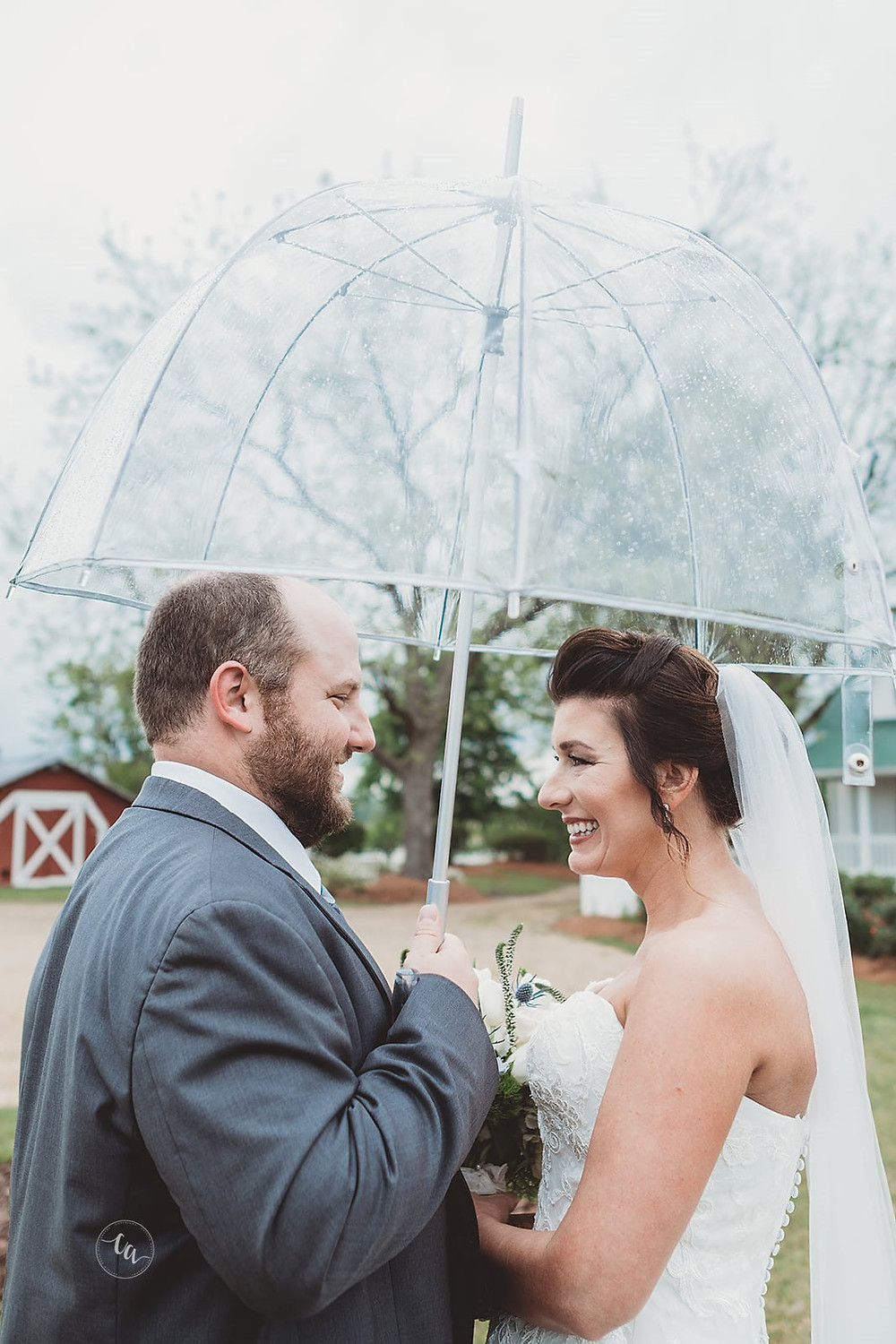 Danielle+Matt under umbrella