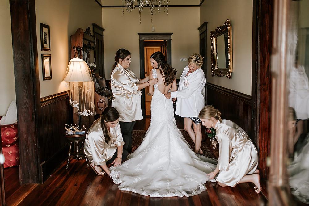 Bride getting dressed (c) AshlynCatheyPhoto